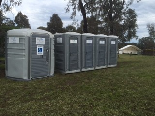 A Disabled Portable toilet and group of portable loos